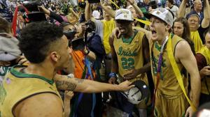 Pat Connaughton and teammates celebrate Notre Dame's 1st ACC Tournament Championship.