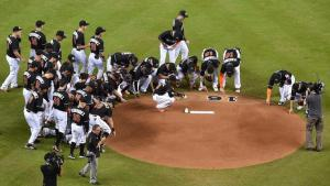 Sep 26, 2016; Miami, FL, USA; Members of the Miami Marlins gather around the mound to honor fallen teammate starting pitcher Jose Fernandez prior to the game against the New York Mets at Marlins Park. Mandatory Credit: Jasen Vinlove-USA TODAY Sports